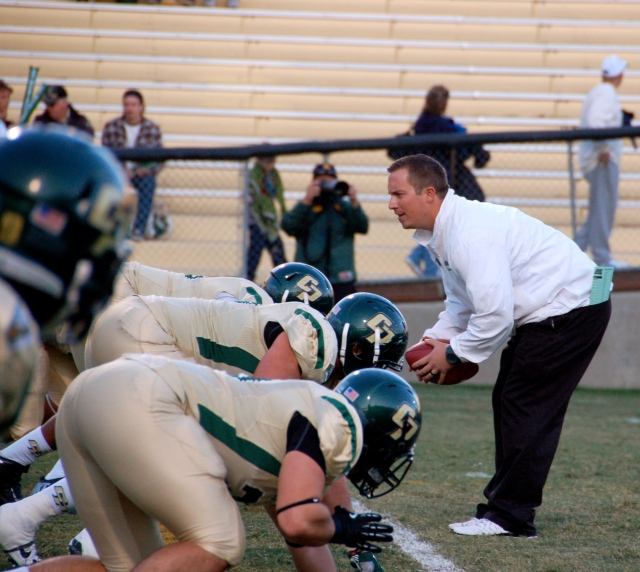Coach Johnston works with the team