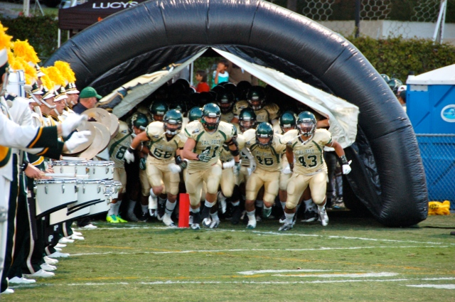 Led by Nick Dzubnar, the team runs out of the tunnel together