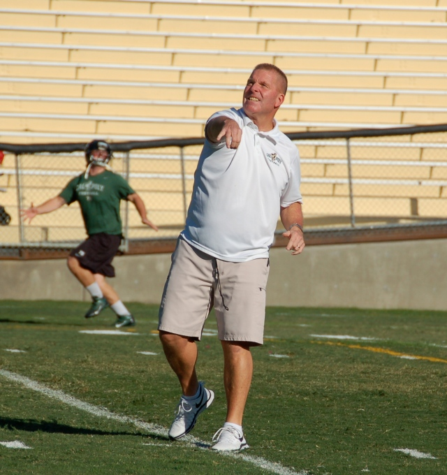 Coach Walsh throws passes to the defensive line