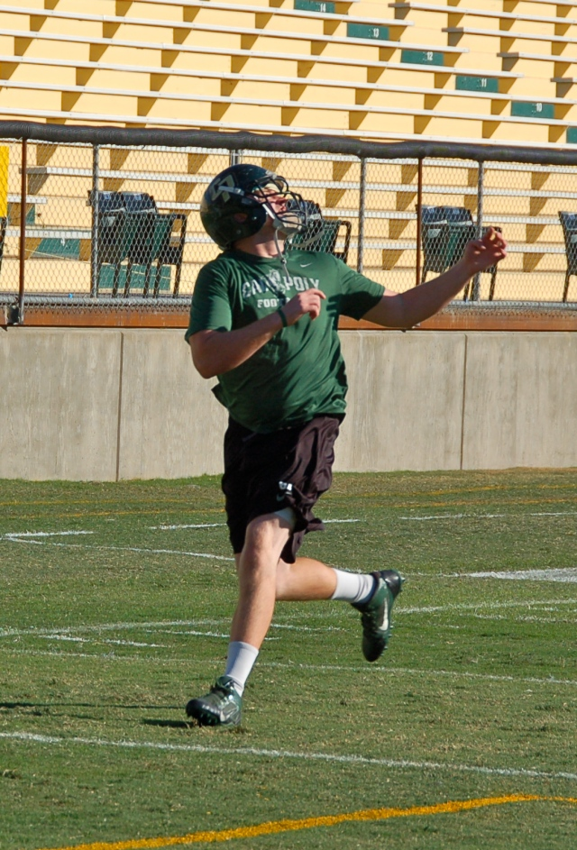 Junior offensive lineman Sam Kenney looks to make the catch...