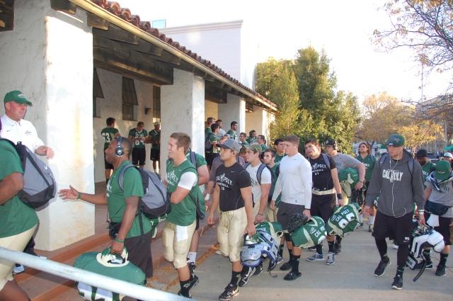 The team walks into the locker room