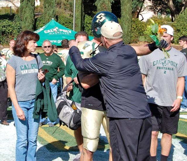 Senior captain Cole Stanford hugs Coach Walsh