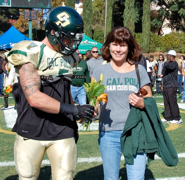 Senior captain and slotback Cole Stanford gives his mom flowers