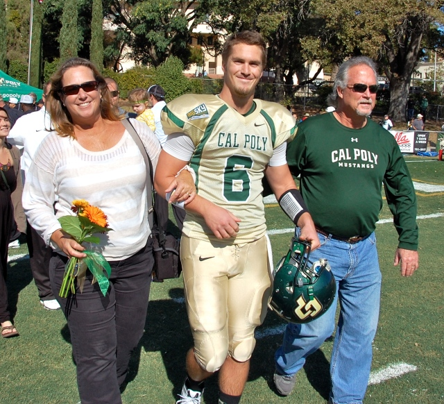Senior quarterback Kenny Johnson and his parents