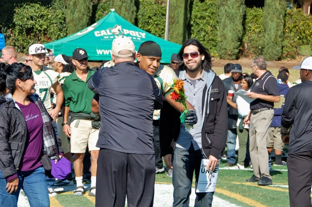 Senior linebacker, Xavier Ramos hugs Coach Walsh