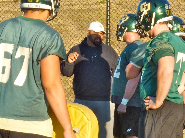 Coach T talks to the offensive linemen