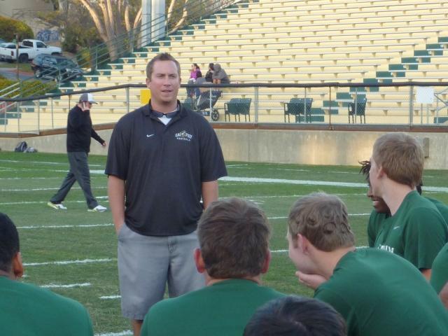 Coach Pat Johnston addresses the team