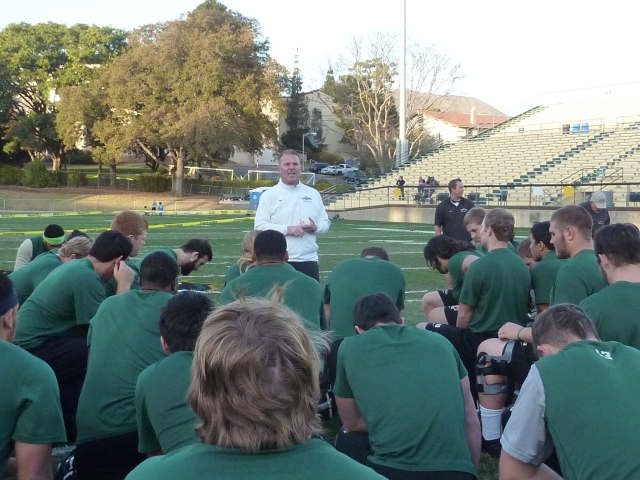 Coach Walsh addresses the team